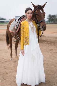 PRATHYUSHA GARIMELLA White Drape Gown with Mustard Embroidered Jacket #prathyushagarimella #white #drape #gown #mustard #embroidered #jacket