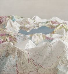 Blocky skylines made from stacked books dominate one side of the gallery in Chinese artist Ji Zhou's new show at Klein Sun Gallery and first U.S. solo show, Civilized Landscape, while crinkled maps become mountain ranges on the other