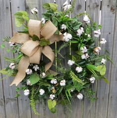 This gorgeous wreath is a perfect natural accent piece to use use all year round! Unique, realistic cotton branches are complimented with rustic