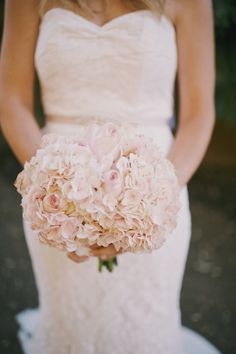 Pale pink hydrangeas and roses for this bride's simple yet stunning #wedding #bouquet. Perfection!