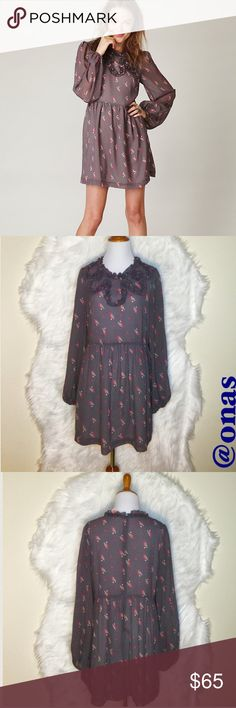 """Free People Monarch Wings Dress Adorable long sleeve dress with crinkle print fabric and high, ruffle neckline. Features elasticized sleeve cuffs and hidden zipler in the back. Semi sheer. Lined. Leght: 33.5"""", Bust: approx. 18.5"""" Waist: 16.5-17"""". NWOT (the color is the same with model). Free People Dresses Mini"""