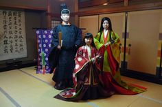 A family dressed in heian era robes at a junihitoe photography experience.
