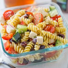 Easy Greek Pasta Salad with a homemade vinaigrette, pasta, feta, and olives is an easy salad you can enjoy at room temperature or with chicken or shrimp.