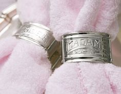 """One of a pair of silver napkin rings that inspired the his-and-hers tile mosaic """"rugs."""""""