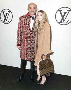 Christian Louboutin and Ashley Olsen showed up to the Louis Vuitton Monogram Celebration together.