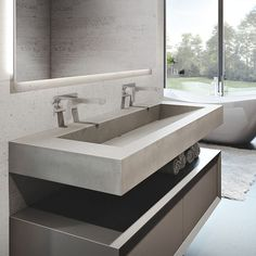 "Trueform 60"" ADA Floating Concrete Bathroom Sink custom designed for a restaurant, bar or hotel. Meets requirements for thickness,…"