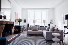 See all our stylish living room design ideas on HOUSE - design, food and travel by House & Garden, including this white living room with a Grey L Shaped Sofa. Living Room Stools, Teal Living Rooms, Living Room Green, Living Room Designs, Small Condo Living, Condo Living Room, Living Room Windows, Grey L Shaped Sofas, L Shaped Couch