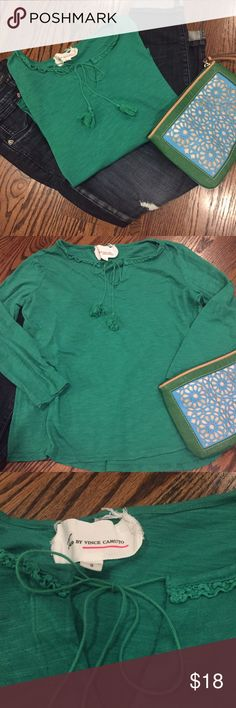 ✨New listing✨ Green Vince Camuto slub knit tee This kelly green slub knit tee is as comfortable as it is cute.  Made with 60% cotton, 40% modal.  The detailed neckline includes tasseled cords to create your own look.  Size Small by Two by Vince Camuto.  In excellent used condition, only flaw is hardly noticeable, but pointed out in pic 4 where the stitching slightly unraveled. Vince Camuto Tops
