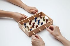 Although it is just like foozball, I like that its smaller and in general I like the idea of a slippery board