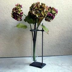 test tube vase with flowers