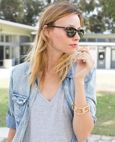 ::a chambray jean shirt is the perfect layering piece for a casual outfit. I love it paired with a gray v neck, black skinny jeans, large black sunglasses and a some layered gold jewelry to pull it all together::
