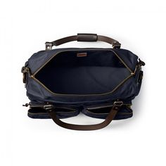 Discover the Filson Duffle bag. Built for overnight travel, weekend trips, and hard work in the field. Duffel Bag, Leather Handle, Navy Tops, Luggage Bags, Shoulder Strap, Top View, Parfait, Dark Blue Colour, Travel Bags