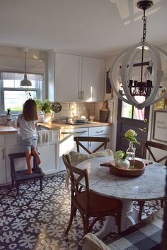 Kitchen ideas. Statement tile. Links to favorite dining chairs at the best prices.