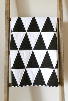 black and white modern isosceles triangle baby quilt.