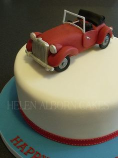 Cake for a classic car enthusiast who owns a red Gentry, similar to an MG roadster and a little black Jackapoo dog.