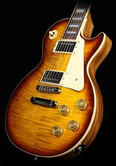 """2015 Gibson Les Paul Standard in Honeyburst Perimeter Candy finish - """"[this] Standard veers from tradition by having a compound 10-16"""" radius, an asymmetrical Slim Taper neck, and a modern weight-relieved body. The electronics expand the sonic palette of the guitar by allowing coil-tapping of the Burstbucker Pro pickups, along with phase reversing."""""""