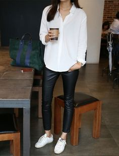 White button-up blouse, black leather skinny pants, white sneakers