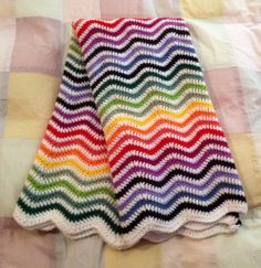 Colourful crochet ripple blanket using the pattern by Lucy@Attic24.