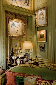 Stunning green velvet settee and recessed alcove not to mention the lovely artwork = the epitome of Old World Style