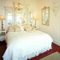 Shabby Chic Mirrors  Three aged mirrors hung behind this bed make a great shabby chic