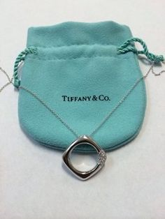 f9961ffbb Tiffany & Co 18K White Gold Square Cushion Diamond Pendant. Get the lowest  price on