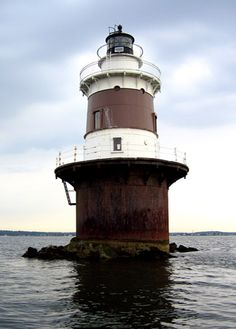 Peck Ledge Lighthouse in Norwalk, CT At the northeast end of the Norwalk Islands, 2 miles from Calf Pasture Park Photo by LighthouseFriends.com  Peck Ledge Light was built in 1906 with the spark-plug type design, popular at the time with a Fresnel lens. The interior included a basement, three floors of living space, a watch room and the cast iron lantern 61 feet in the air. The light was automated in 1933. In 1990 the Coast Guard repaired the light.