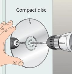 To drill perpendicular holes with a handheld drill, here's an inexpensive solution. Grab a compact disc (scratched ones that won't play work just fine for this) and center it on the hole mark. As you drill the hole, watch the reflection in the CD—keep the bit in a straight line with its reflection for a perpendicular hole every time. —Robert Heil, Wheeling, W.Va.