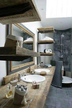 Reclaim barn wood shelves, exposed shower pipes, & colors