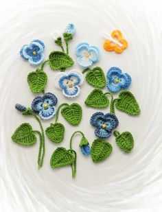 Crochet Applique Pansy Viola Flowers and Leaves by CraftsbySigita