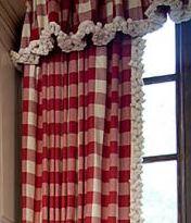 Red buffalo check drapes and pompom trim <3