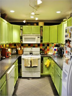 Fetching Pictures Of Green Kitchen Cabinets : Interesting UShaped Light Green Kitchen Cabinet with Black Granite Countertop and Colorful Tile Backsplash also Nice Hidden Lighting