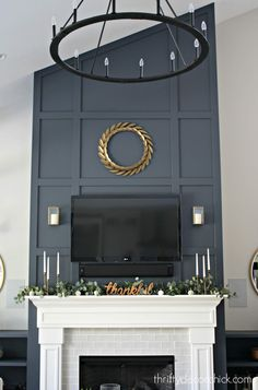 from Thrifty Decor Chick makeover before and after Dramatic fireplace wall makeover! from Thrifty Decor Chick makeover before and after Dramatic fireplace wall makeover! Fireplace Trim, Fireplace Feature Wall, Fireplace Tv Wall, Tall Fireplace, Farmhouse Fireplace, Fireplace Remodel, Modern Fireplace, Fireplace Design, Fireplace Mantels