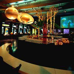 L.A. Premier set up towering flower arrangements on the bars.