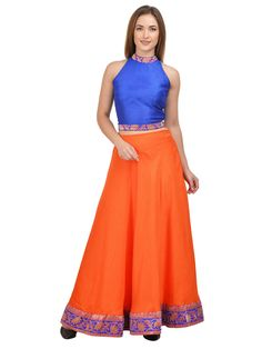 Flaunt your toned Skin in the most attractive manner by wearing this orange Lehenga With royal blue crop top by Castle. Simple and classy in design, this flared skirt is also extremely soft against the skin, courtesy the fine dupion silk fabric.