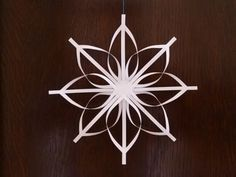 The secret of how to make a star ornament that looks beautiful and intricate, but is surprisingly simple to make. A homemade Christmas decoration your friends will marvel at!