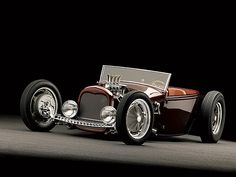 1929 Ford roadster pickup. This root beer colored beauty is perfectly trimmed in leather and has an amazing period specific toolbox plus the gauges are spectacular
