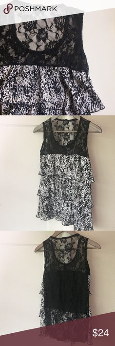 """Lace & Ruffle Top Lace & Ruffle Top. Scoop neck tank. Neckline drops about 5.5"""". Total length about 25"""" from top of shoulder to hem. In front: sheer lace top with 3 tiers of black and white ruffles. Back is all sheer lace. About 15.5"""" underarm to underarm. Tank straps 2"""" wide. Fabric and size unknown - tags have been removed. I'm guessing it's Polyester and fits a small. Previously loved and in good condition. Tops"""