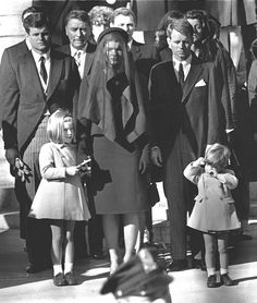 Jacqueline Kennedy stands with her two children Caroline Kennedy and John F. Kennedy, Jr and brothers-in law Ted Kennedy, left back, and Robert Kennedy, right, at the funeral of her husband President John F. Kennedy, Nov. 26, 1963 in Washington.