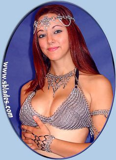 Chain mail metal fashion tops, body chains & bikini tops made in metal & chains Chainmail Top, Touch Of Gray, Medieval Wedding, Slave Bracelet, Metal Fashion, Renaissance Fair, Belly Dance Costumes, Chain Mail, Metal Chain