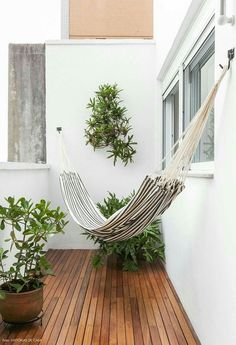 27 Small Balcony Decor Ideas 💡💡 I'd totally use a small space like this, to make a nice little reading book 📚📙 with a Hammock. Super cute & quiet! #homedecor #smallspaces #hammock #readingnook