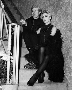 1966 - Andy Warhol and the fabulous Edie Sedgwick seated on the stairs, black and white vintage photo, marabou coat 1960s mod black eyeliner, satin gloves, damask wallpaper