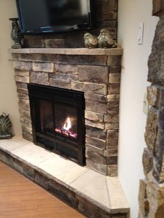 Side view of corner fireplace- love the sitting area and little mantle!