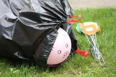 Pig corralling game.    Draw a pig face on a balloon. Try to corral it into a garbage bag using fly swatters.  #play #children #games #birthdayparties #birthdays #kids