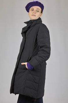 Pleats Please Issey Miyake | knee-length padded jacket in opaque nylon cloth and feather padded | #pleatsplease