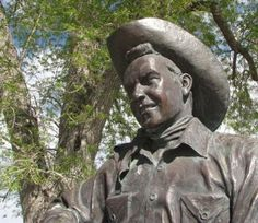 A larger-than-life bronze of cowboy movie star Rex Allen sits across the street from the museum dedicated to him in Willcox.