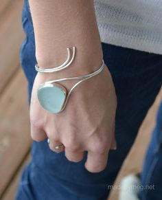The Laura sea glass bracelet is a statement piece that is perfect for a wedding or everyday. The smooth lines and hint of an ocean wave complete this bracelet with a genuine shard of blue sea foam sea glass. Jade Jewelry, Sea Glass Jewelry, Modern Jewelry, Jewelry Bracelets, Silver Jewelry, Gold Jewellery, Silver Ring, Glass Earrings, Silver Earrings