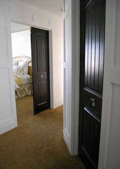 Black interior doors and full wall trim? Love the numbered doors!