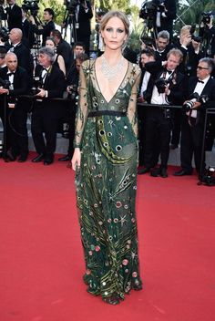 Poppy Delevingne's custom emerald green Burberry gown has mirrors interspersed throughout the boho print. The laid-back but still black tie look's made even more fancy with a diamond Chopard statement necklace.