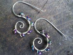 Silver earrings with magnetic rainbow hematite  by spiralcraft, via Flickr