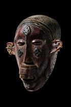 """Makonde female mask with lip plug - these proportionally small masks were fastened to the forehead. The remaining part of the head is covered with fabric through which the performer breathes and looks. The most spectacular however was, that the dancers wore stilts measured up to three meters, which is why the term """"stilt dancer"""" is inseparable attached to the Makonde.  H: 22 cm"""